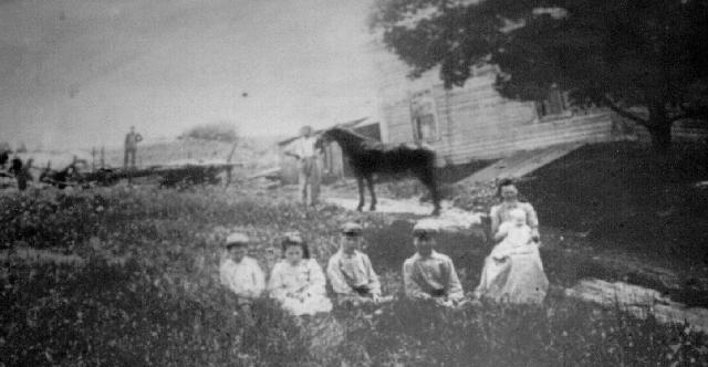 Frank M Burdett and Family, on the Farm
